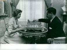 A woman and a man playing chess.  - 1958