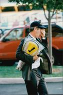 A tired John McEnroe arrives at Flushing Meadows in front of the US Open 1998