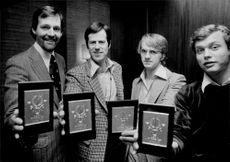 The 1976 Olympic Games team receives gold placards.