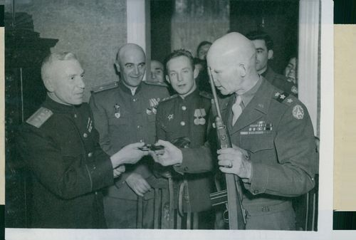 Russian General Sviataiev and American General Simpson at the Russian Ve-Party. They are pictured exchanging presents with each other.