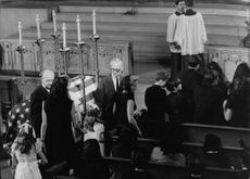 "Robert Francis ""Bobby"" Kennedy family standing in church."