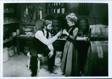 """1985 A scene of Kevin Delaney Kline and Lydia Susanna Hunter from the  American Western film produced and directed by Lawrence Kasdan """"Silverado""""."""