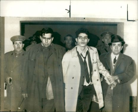 Mariano Ventura Rodriguez with the police.