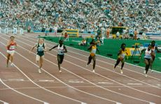 A photograph of athletes running during a competition.