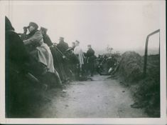 Soldiers looking at the enemies from their bunkers during First World War.