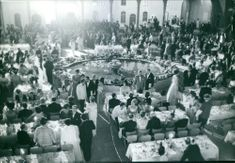 People gathered in luxurious party, having discussion and meal.