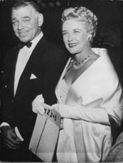 Clark Gable and Kay Williams smiling.