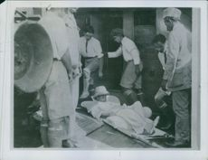 Medical men helping a wounded man on a stretcher during the First World War.