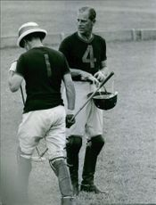 Prince Philip playing a sport in the field.
