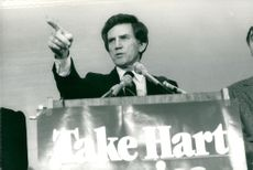Gary Hart talks during a press conference in Washington