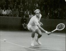 Tennis player Stan Smith throws himself at the ball during a match.