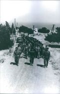 Soldiers are marching in a road of Lebanon.