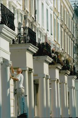 A painter examines the houses in Nothing Hill