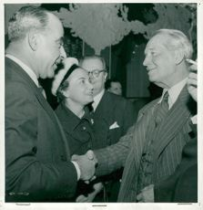 Dir. Ragnar Sachs and Mrs Janine Found with Maurice Chevalier