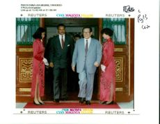 Jiang Zemin Former General Secretary of the Communist Party of China and two chinese girl.