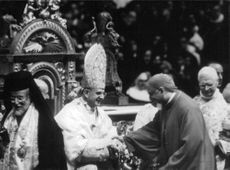 Man shaking hand with Pope Paul VI.
