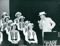 Frank Sinatra performing on stage.