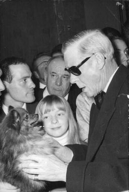 Duke of Windsor playing with the dog.