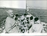 Gaston Defferre traveling by boat with other men.  1967