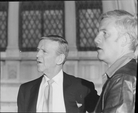 Side pose of Fred Astaire and Alf Kjellin.