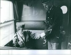 A photo of a police handcuff the man on a bus. August 15, 1960