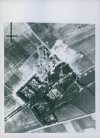 A stick of bombs bursting on newly-built hangers on the aerodrome at Desvres, near Boulogne.