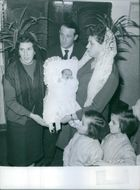 Foglia twins with family at baptism of younger sibling.