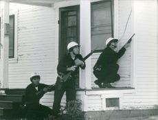 Police on mission with guns. Photo taken 1965