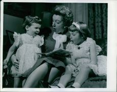 Dedorah Kherr as mother, passing time with her two kids.