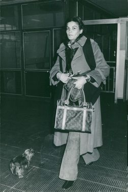 Woman walks out together with a dog.