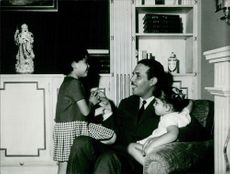 Mehdi Ben Barka siting with children.