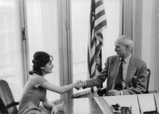 Shahnaz Pahlavi shaking hand with a man.