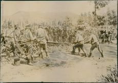 Soldiers operating old fashioned cannons.