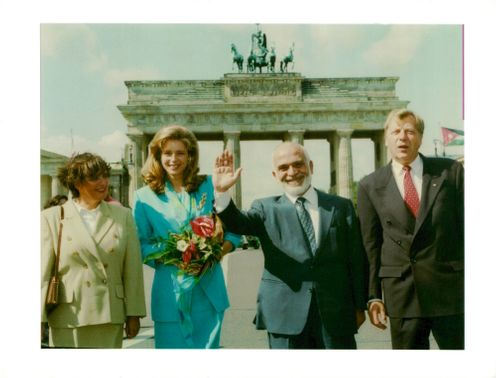 Hussein of Jordan with two women and one man.