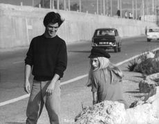 Catherine Deneuve and nab beside road.