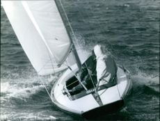 Man travelling on a sail boat.
