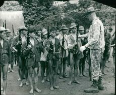 Vietnamese villagers being trained by American advisers during Vietnam War