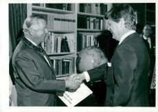 Director and camera designer Victor Hasselblad receives Pro Patrias medal by Holmberg, governor of the city during his 70th birthday.