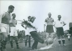 1943 Barbro Kollberg  kicked football to start the play of footballer.