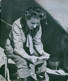 An English nurse reading a piece of paper near the temporary hospital in Italy during World War II in 1944