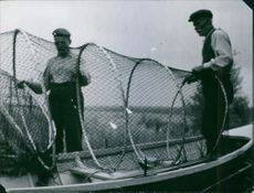 Edward Dahlberg and another man preparing their fishing gear. Photo taken in 1940.