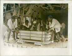 Africans unloading 23-ton consignment from C-130 Hercules plane during Zambia Crisis 1965