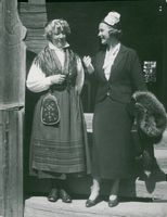 Actress Grace Moore next to a woman with folk costume at Skansen