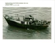 A group of  Vietnamese chinese boat people crowd.