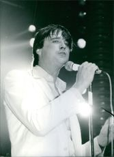 Marquis of Worcester singing on the microphone, 1985.