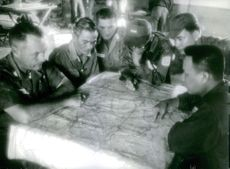Vietnamese and U.S. soldiers in Vietnam plan their war strategy.  - Jan 1964