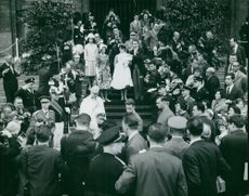 Albert II of Belgium and Queen Paola of Belgium coming out of a building.