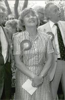 Shirley Williams standing with other people in the event.