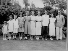 Joseph Kennedy with his wife and 8 of their 9 children - Year 1930