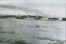 Landing craft carrying U.S. Marines forge steadily ahead for the amphibious assault on Bougainville Island.